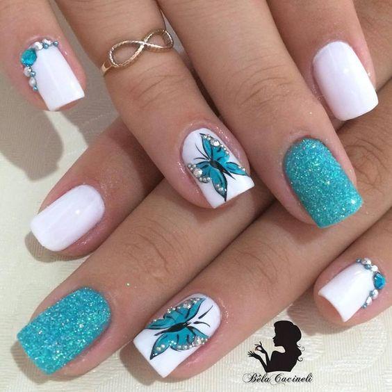 unhas decoradas borboletas azul